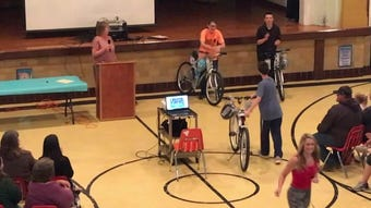 Teacher Lisa Lupher distributed bicycles from the Louis McCain Bicycle Fund to sixth-graders Kaleb Anderson, Gavin Guilliams, Audri Cramer and Shaelyn Yoder on the last day of classes at Union Elementary.