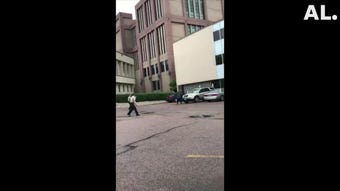 A witness recorded video of an officer-involved shooting in front of the Minnehaha County Jail in downtown Sioux Falls on Tuesday.