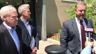 Lawyer Brooks McArthur stood beside client Bill Stenger on Wednesday, May 22, 2019, after Stenger pleaded not guilty to criminal charges related to visa fraud.