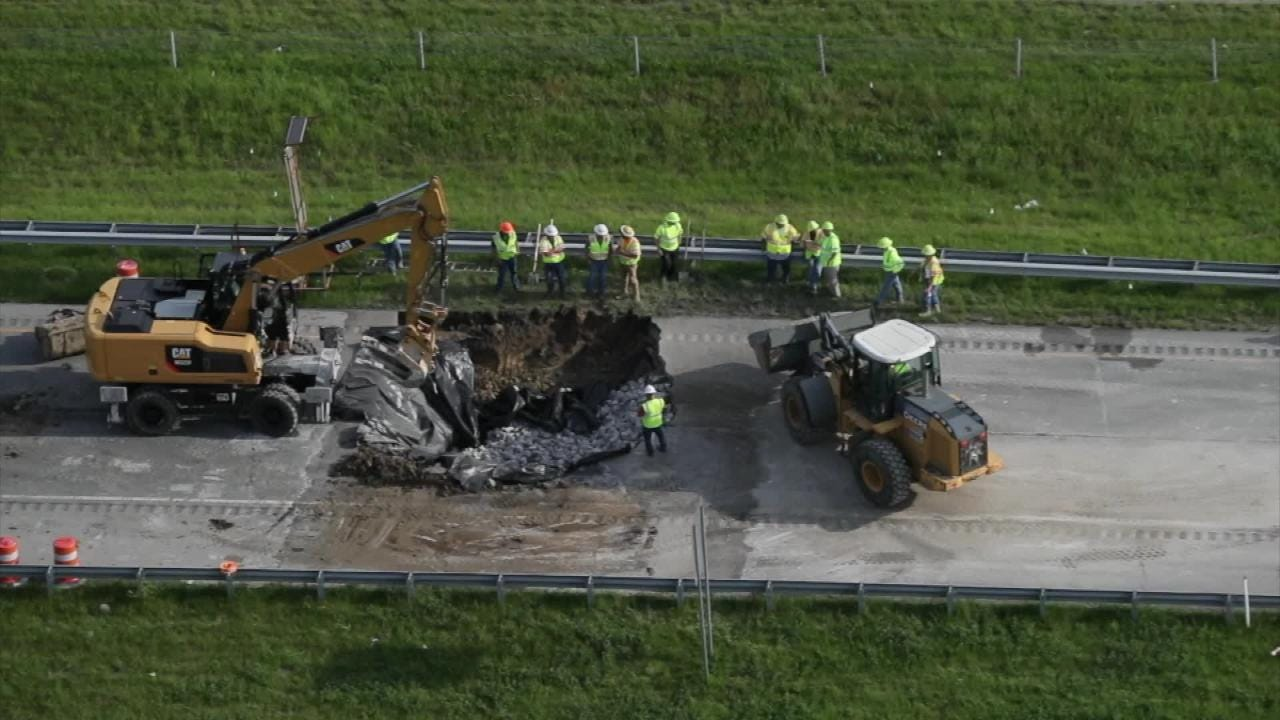 A sinkhole opened up in Southern Indiana  Watch as workers move to fix it