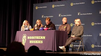 Seated with his family, Port Huron Northern junior Braiden McGregor announces his college decision Friday, May 24, 2019 in the auditorium at Port Huron Northern High School.