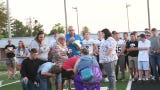 The North Buncombe community sings Amazing Grace during a vigil for Dillon and Ronnie Akins and Johnny Laws on May 28, 2019.