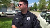 Menasha police officer Nick Oleszak talks about the resolution of a standoff in the 800 block of Fifth Street.