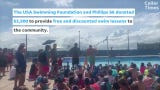 Olympic Swimmers Give Local Youth Swim Lessons