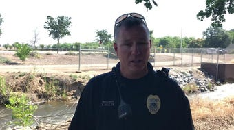 Sgt. Brent Miller discusses efforts to clean up homeless camps on private property along Mill Creek Trail in Visalia