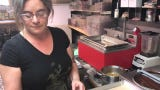 Liz Knapp, one of four co-op owners at Nutty Steph's chocolates shows how chocolate and chocolate confections are made in the company's kitchen.