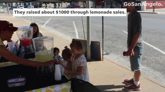Harley Ratliff and her friends used their lemonade stand to help two media teams raise money for NOAA radios for the elderly Saturday, June 8, 2019.