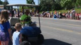 Osman Shrine Go Karts travel down Riverside Avenue for a parade during the Sartell SummerFest Saturday morning.