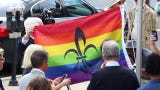 A crowd attended the LGBTQ Pride flag raising outside Metro Hall, led by Louisville Mayor Greg Fischer. The mayor declared June 10-17 Pride Week.