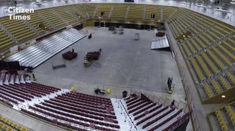 Watch the arena of the U.S. Cellular get set up for a concert, disassembled and set up for a gymnastics competition the next day.