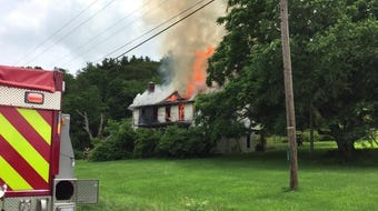 A vacant house off Dresden-Adamsville Road was in flames on Wednesday afternoon.