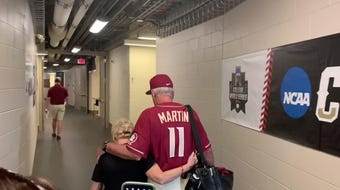 FSU coach Mike Martin walks out of TD Ameritrade Park for the last time as the Seminoles' head coach.
