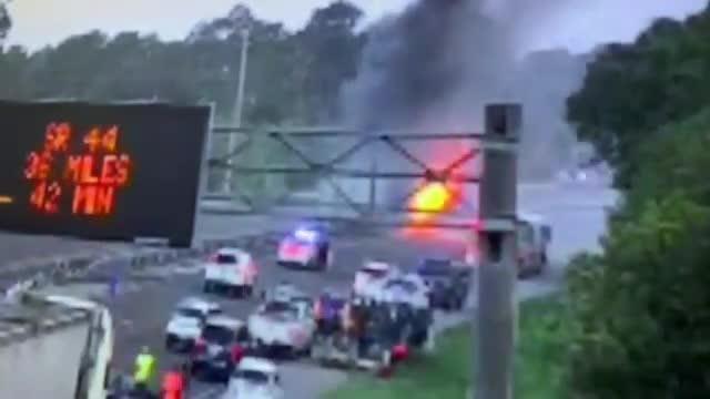 Tractor-trailer on fire, blocking I-95 near Titusville