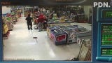 Video footage shows two armed men threatened a cashier and stole money from the register at San Jose Supermarket at about 4:30 a.m. Sunday, June 23.