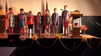 "German School in Alamogordo students perform  ""Auf ins Abenteuer"" at the school's closing ceremony June 21."