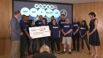 A group of co-workers who won a $1 million lottery prize celebrated in Clive in June 2019.