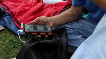 Renova Energy hands out solar chargers to the homeless.