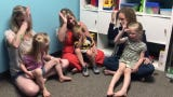 Teacher Elizabeth Woods, and parents Kamie Wittrock and Andrea Boerigter help their children Ivy and Iris Wittrock and Gus Boerigter sing the song, 'Baby Shark,' using sign language June 27, 2019 at Bloom, an indoor playground and child development center.