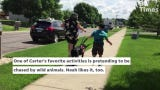 Noah the black lab helps 7-year-old Sauk Rapids resident Carter — who has autism — run and walk and play without the fear of him running away.