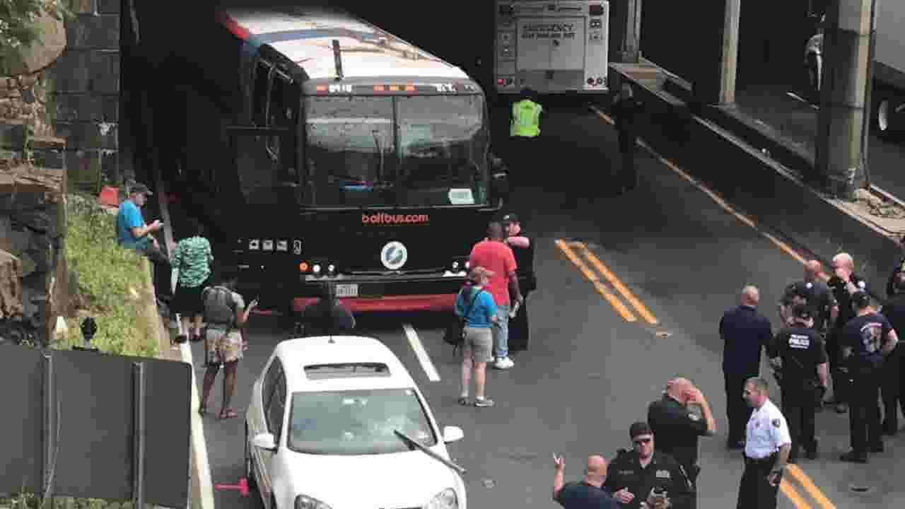 Garbage truck falls off overpass onto Route 495