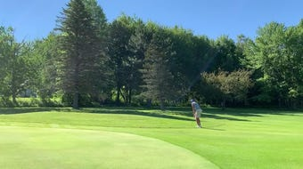Brock Paquette pitches onto the second green to get up and down for par at Williston Golf Club.