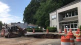 A sinkhole off Merrimon Avenue in Asheville reopened after an inch and a half of rain four days after it was filled with 200 tons of road bond.