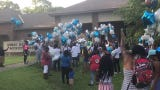 Family members release balloons in honor of Mar'Kavin Cormier, a 2-year-old who was fatally shot.
