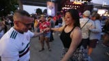 People dance the Salsa as Van Lester and the Hector Lavoetribute band perform at the Summerfest Harley-Davidson Roadhouse stage.