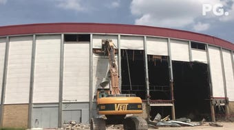 Crews strip facade from Brown County Veterans Memorial Arena
