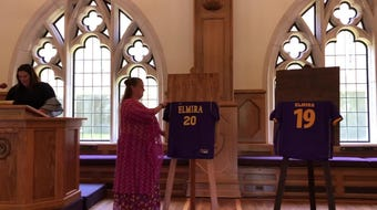 Elmira College Athletic Director Renee Carlineo talks about past EC logos as the  college's new logo is unveiled July 10, 2019.