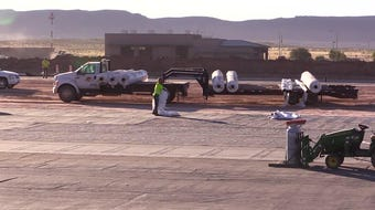 Crews continue work on the airport runway.