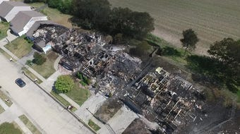 Drone video shows the damage created by a fire that destroyed five houses, and damaged many others.