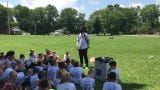 Former Ohio State quarterback J.T. Barrett talks with campers at the Brian Sampson Memorial Youth Football Camp ion Friday.