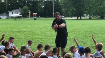 Former Ohio State linebacker Anthony Schlegel gave a passionate speech to campers at the Brian Sampson Memorial Youth Football Camp.
