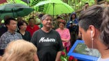 Merizo Mayor Ernest T. Chargualaf and Gov. Lou Leon Guerrero discuss the history of the Tinta massacre during a site visit in Merizo on July 15, 2019.
