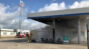 The fire was at a gas station on Ambassador Caffery near Interstate 10.