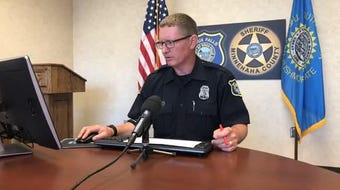 Sioux Falls police spokesman Sam Clemens goes over the call log during Thursday's briefing.