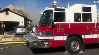 Reno Fire responds to two houses on fire on Golden Valley Rd in Reno on July 18, 2019.