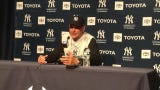 Manager Aaron Boone does not regret getting ejected as a way of standing up for his Yankees but admits he's not proud of the language he used.