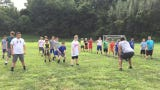 Youngsters learn about football at Future Stars Camp on Saturday at Rosecrans High School.