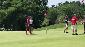 Jo Baranczyk rolls in a par putt on the 18th hole during the second round of the U.S. Girls Junior Championship on Tuesday at SentryWorld.