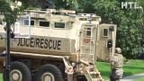 SWAT team responds to Novi barricaded gunman. Listen at about 1:32  as they break a window to toss in the yellow communications box they're carrying