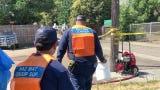 Tulare Kings Hazmat team investigates five-gallon buckets found near Laurel Avenue and Court Street in Visalia.
