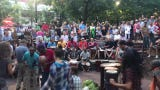 People dance and play drums at the drum circle at Pritchard Park August 2, 2019 in Asheville.