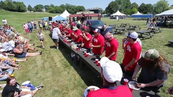 20 contestants battled to see how many bratwurst they could eat at Brat Days in Sheboygan, Wis.