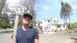 Jim Halbrook has been walking back and forth in front of a 12-home neighborhood on Bainbridge Island for a year now.