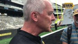 Iowa athletic director Gary Barta spoke to reporters at Kids Day at Kinnick, with the $90 million project towering behind him.