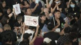 One of the world's busiest airports canceled all flights after thousands of pro-democracy demonstrators crowded into Hong Kong's main terminal Monday.