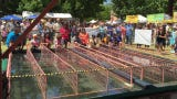 Wet track duck racing during the Great American Duck Race in Deming, NM