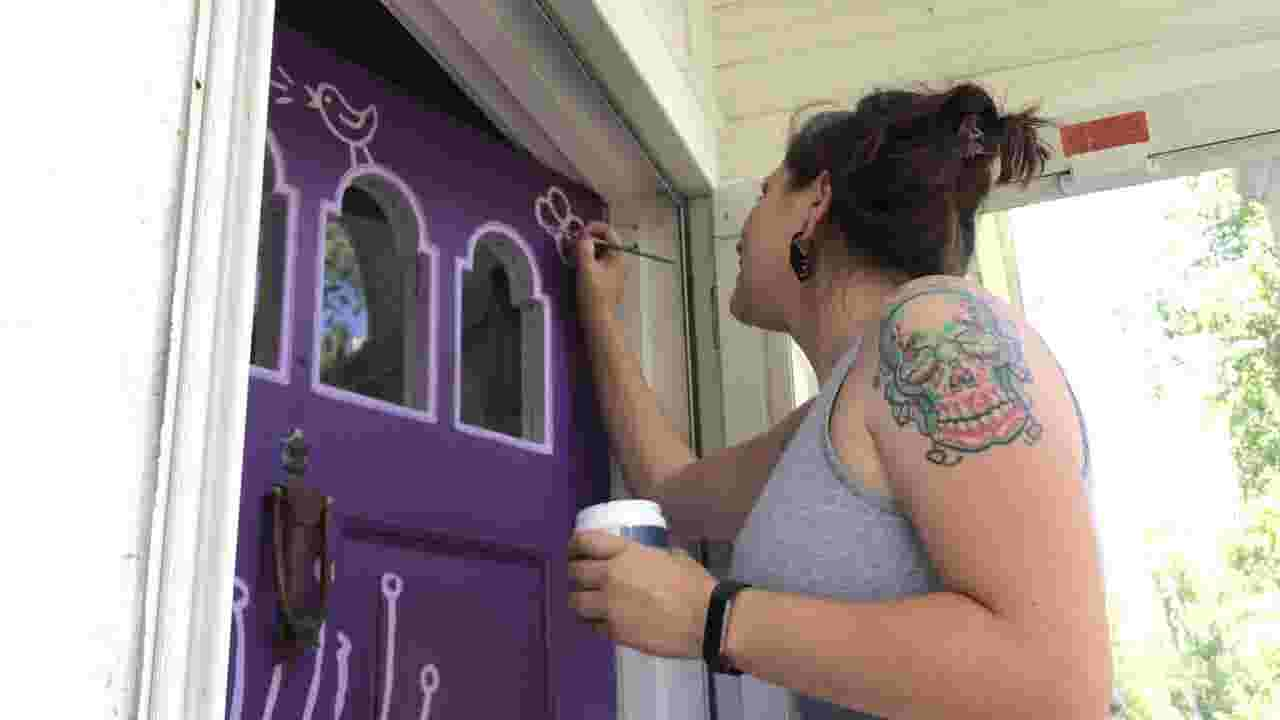 'People want something bold': East Lansing artist gives front doors a colorful makeover